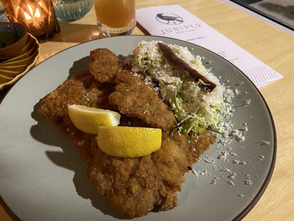 chicken schnitzel and brussels sprout ceasar salad fine dining at juniper restaurant in wolfville nova scotia