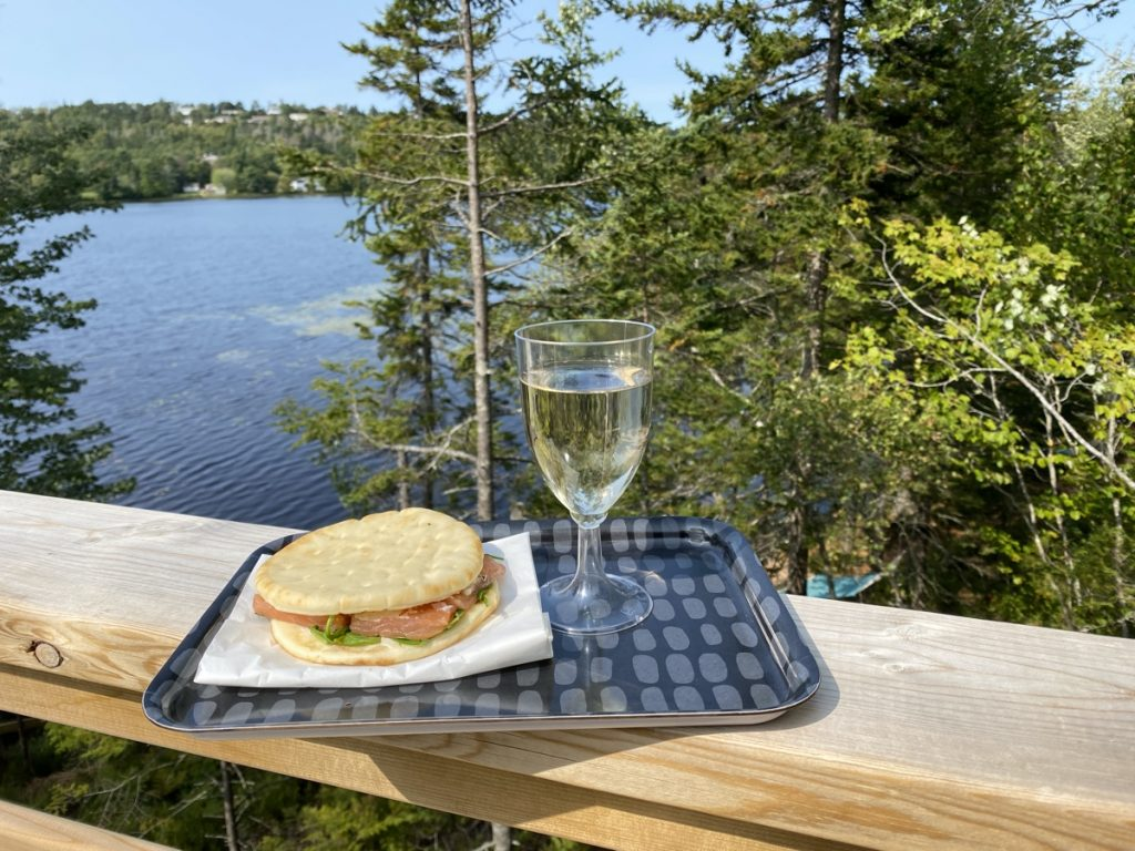 a smoked salmon sandwich and glass of tidal bay at the sensea nordic spa relaxation yurt