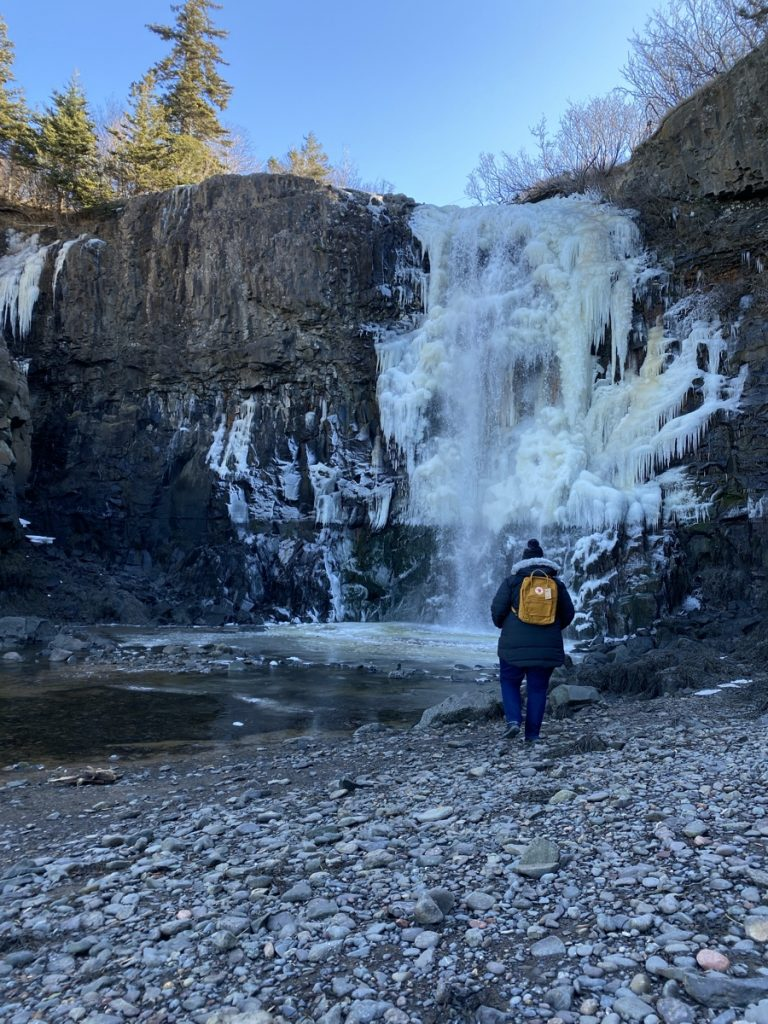 the beautiful baxters harbour waterfall frozen in the winter in Nova Scotia