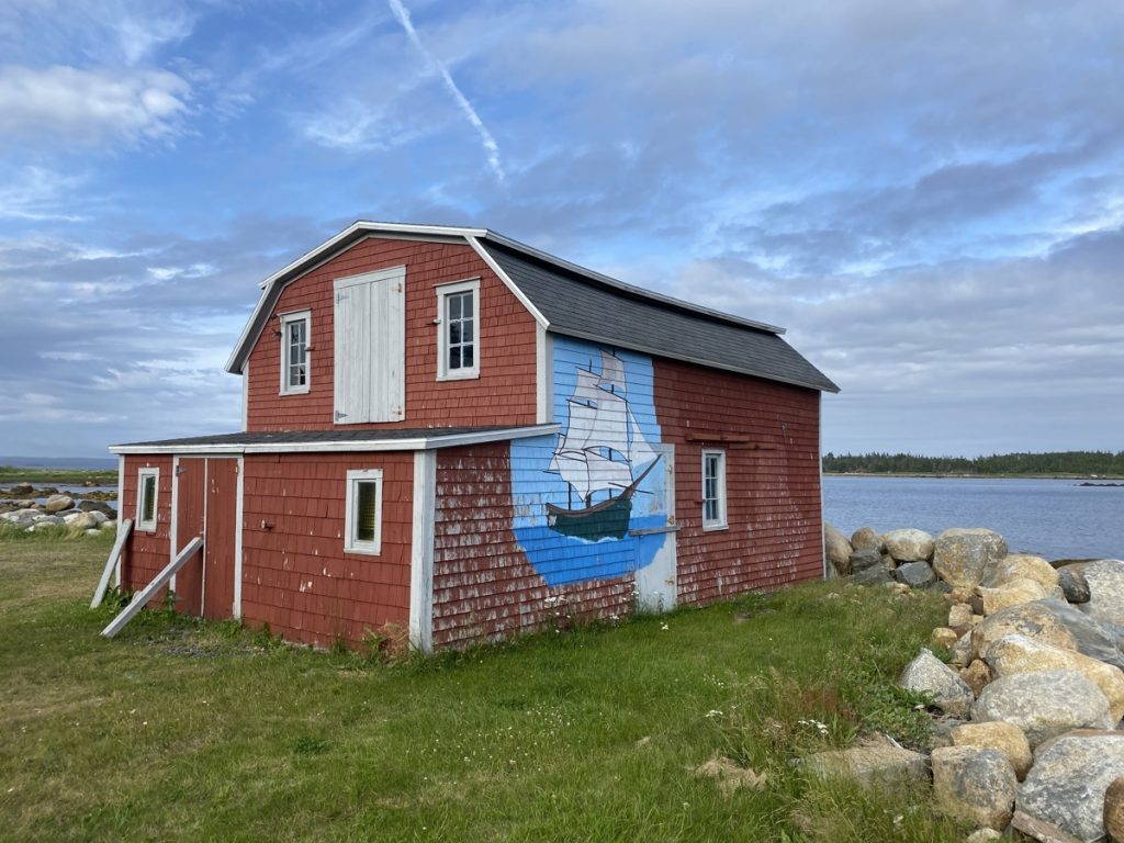 Tor Bay sailboat on boat house THE BEST GUIDE FOR EXPLORING THE EASTERN SHORE OF NOVA SCOTIA