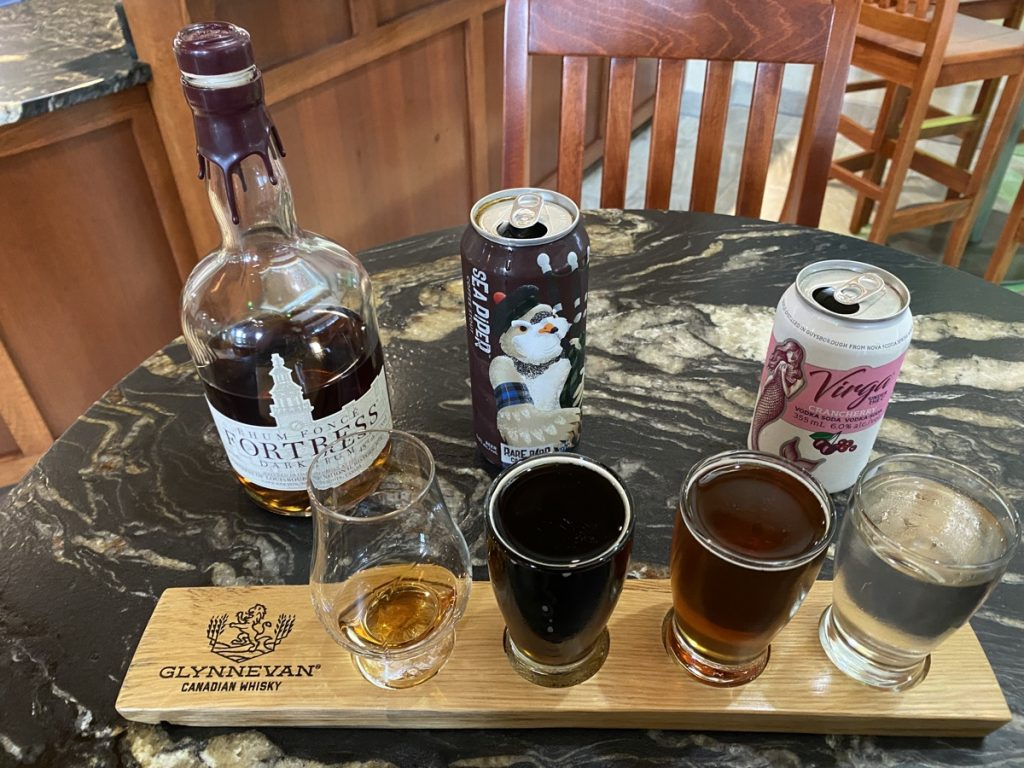 a flight of beer and spirits at the authentic seacoast distillery in guysborough nova scotia