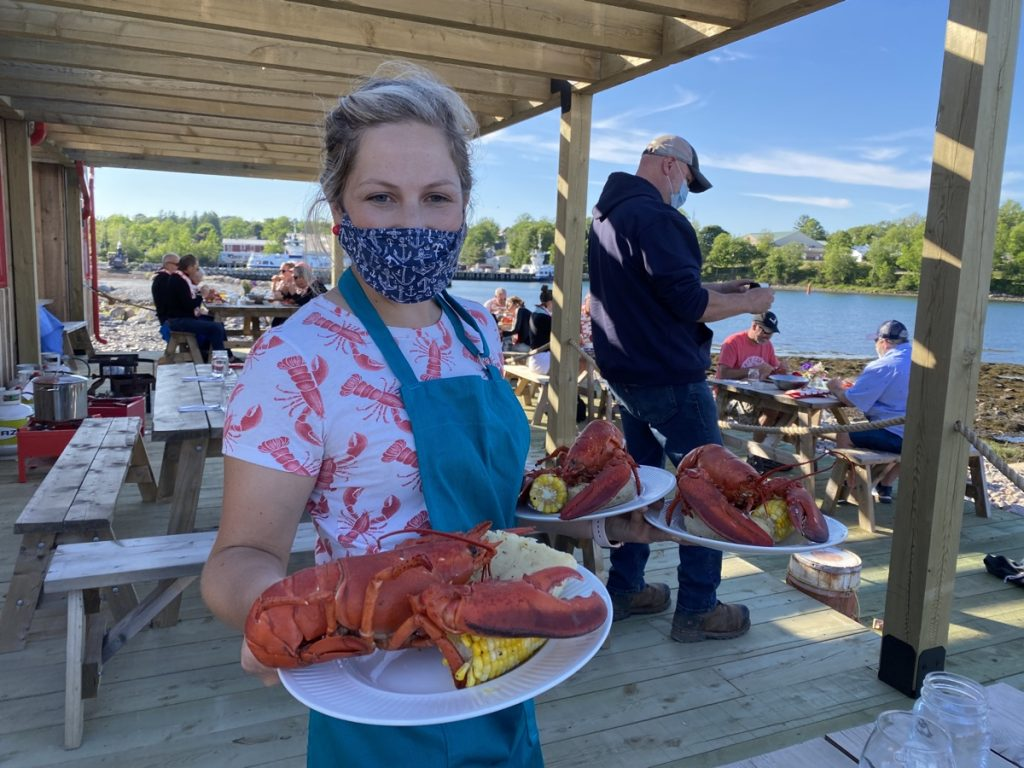 lobster dinner at the lightship brewing beer garden with dory mates seafood shop in lunenburg