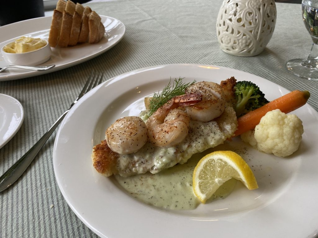 panko crusted haddock with shrimp and scallops in a creamy dill sauce at the dining room in the bluenose lodge lunenburg restaurant